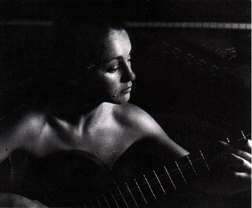 From my youth (summer of 1979). Photo by Helen McNeish ©. And no, I am not wearing only the guitar: there is a strapless swimsuit in there... somewhere.